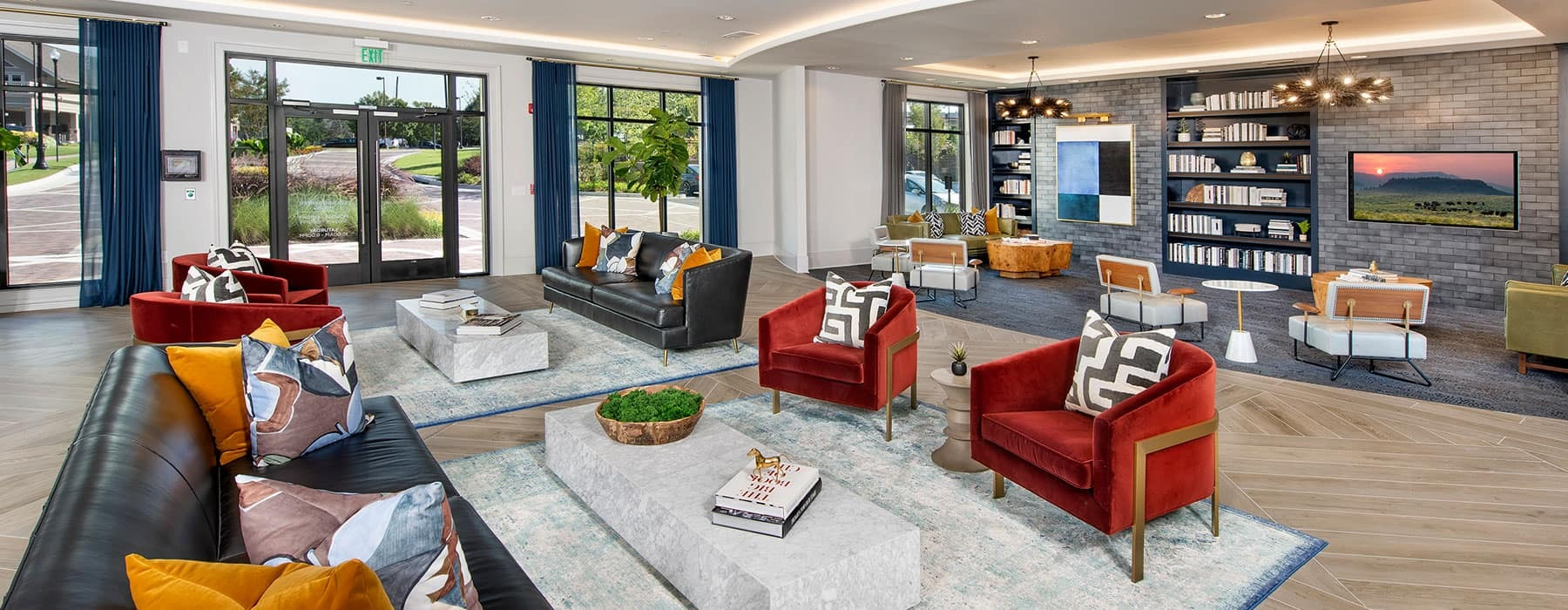 spacious lounge area with ample shared seating and modern decor